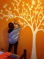 Painting murals at the hostel